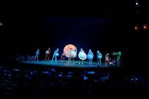 "Breathtaking staging, lighting and costumes from ""The Planet Song"""