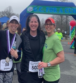 Danielle Gaudio-Lalehzar at the finish line of the GC For a Cure 5K with friends