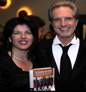 Bob Gaudio with his daughter Danielle holding Jersey Boys program