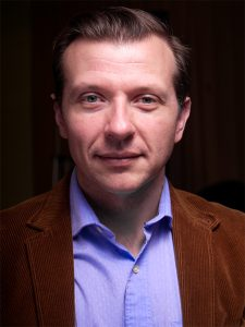 Headshot of HAPA Director Scott Sowinski in an open collar shirt and blazer